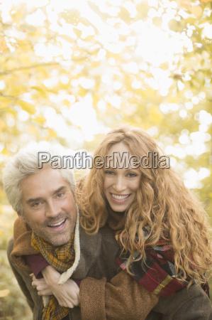 portrait smiling playful couple piggybacking under