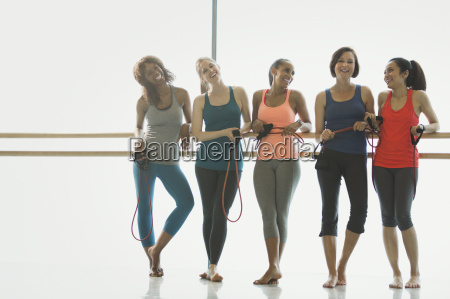 portrait smiling women with resistance bands