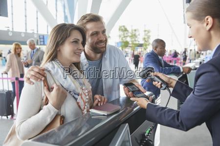 customer service representative scanning smart phone