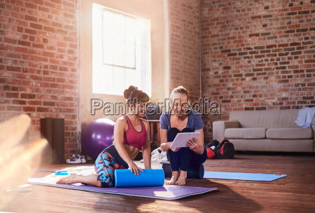 fitness instructor and young woman using