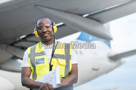 air traffic controller with clipboard under