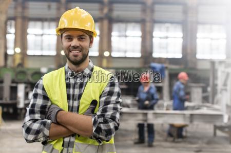 portrait smiling confident steel worker in