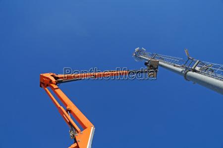 hydraulic mobile construction platform elevated towards