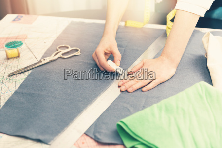tailor occupation marking fabric with