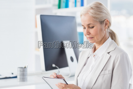 female therapist writing notes