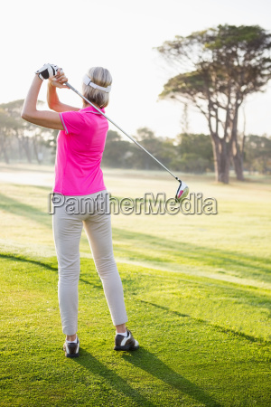rear view of sportswoman playing golf