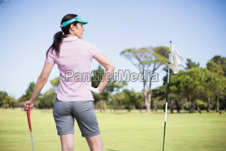 rear view of woman holding golf