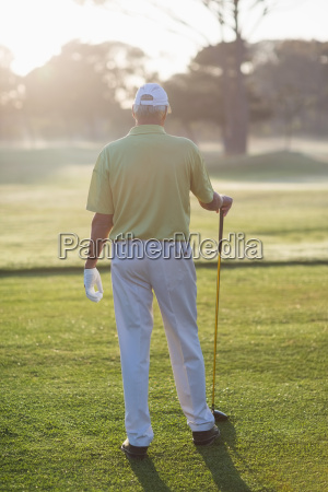 rear view of man holding golf