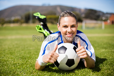portrait of female football player lying