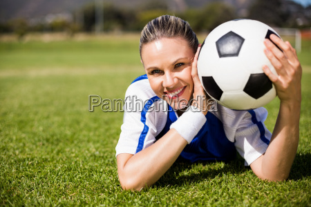 portrait of female football player lying