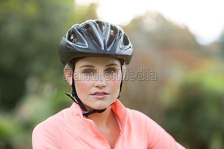 female athletic wearing bicycle helmet