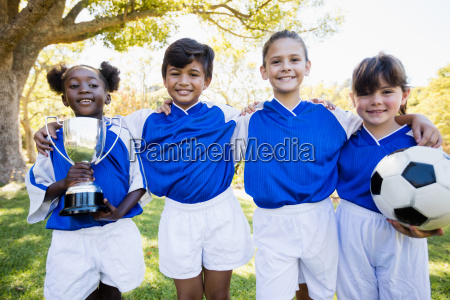 children soccer team in raw smiling