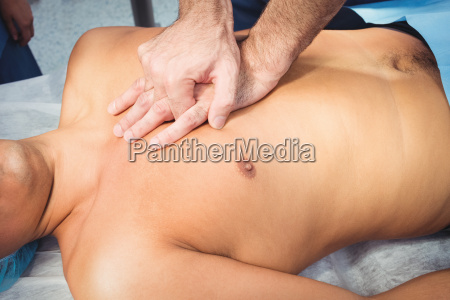male surgeon performing cardiopulmonary resuscitation on