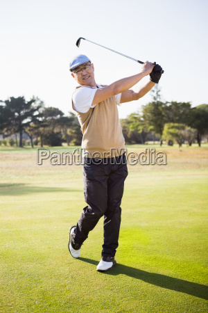portrait of sportsman playing golf