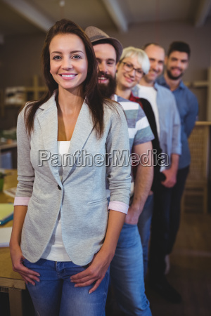 happy coworkers standing in row at