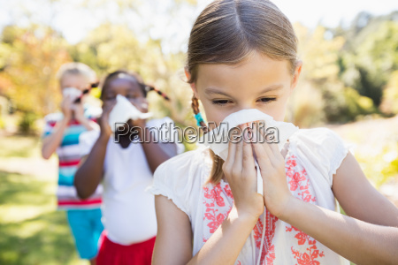 kids are blowing during a sunny