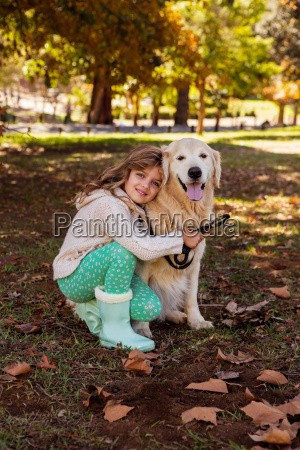 little girl posing with her dog