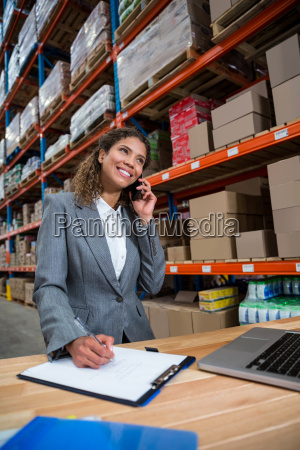 business woman calling on her desk