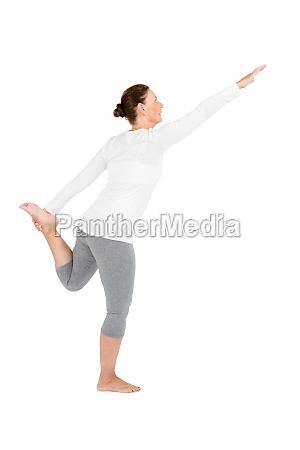 full length of mature woman exercising