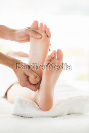 cropped image of woman receiving foot