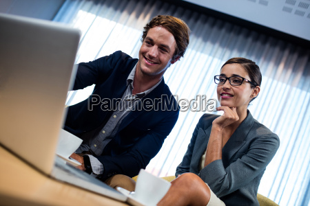 low angle view of business associate