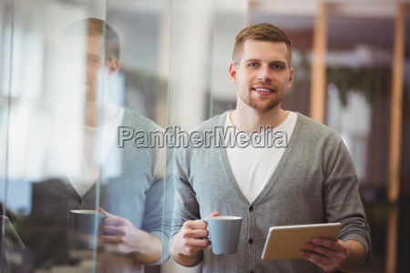 businessman holding coffee cup with digital