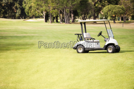 alone golf buggy on golf course