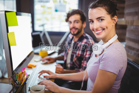businesswoman working with male colleague at