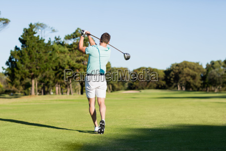 rear view of young golfer man