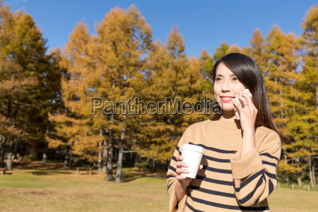 woman talk to cellphone and holding