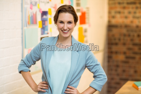 portrait of businesswoman standing with hands