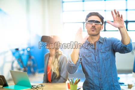 young man using the virtual reality