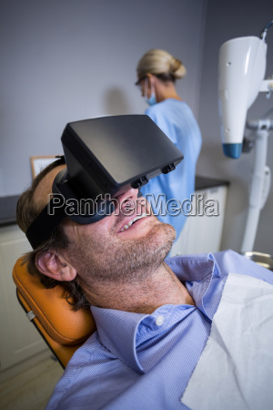 smiling man using virtual reality