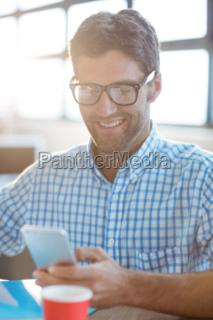 male business executive using mobile phone
