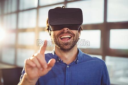 male business executive using virtual reality