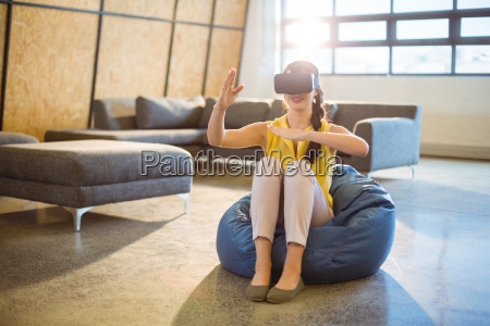 female business executive using virtual glasses