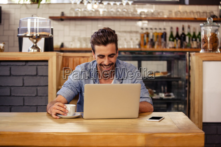 happy hipster man using tablet and