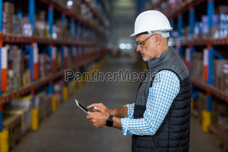 side view of serious worker is