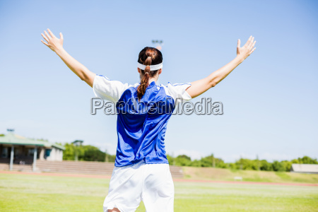 rear view of soccer player posing