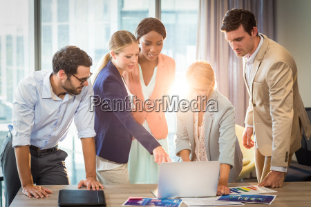 group of business people interacting using