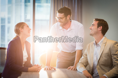 businessmen and businesswoman interacting at their