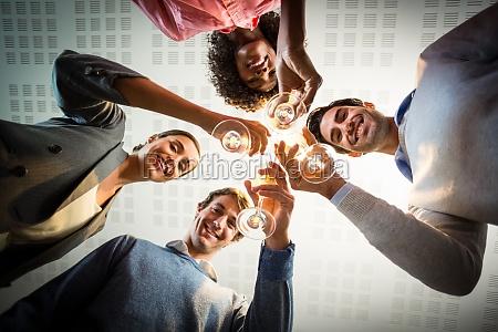 portrait of business people toasting wine