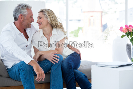 romantic mature couple sitting face to