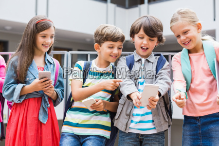 kids taking selfie with mobile phone