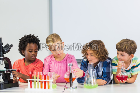 kids doing a chemical experiment in
