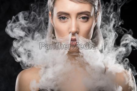 portrait of woman in bodysuit exhaling