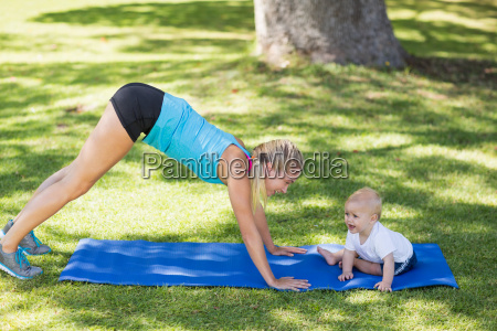 woman exercising with her baby