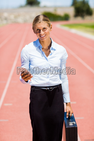 portrait of businesswoman standing with mobile