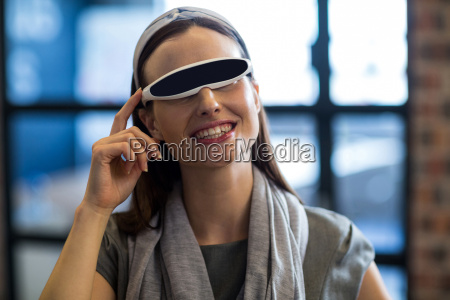 businesswoman using virtual reality headset