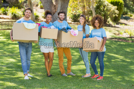 group of volunteer holding cartons